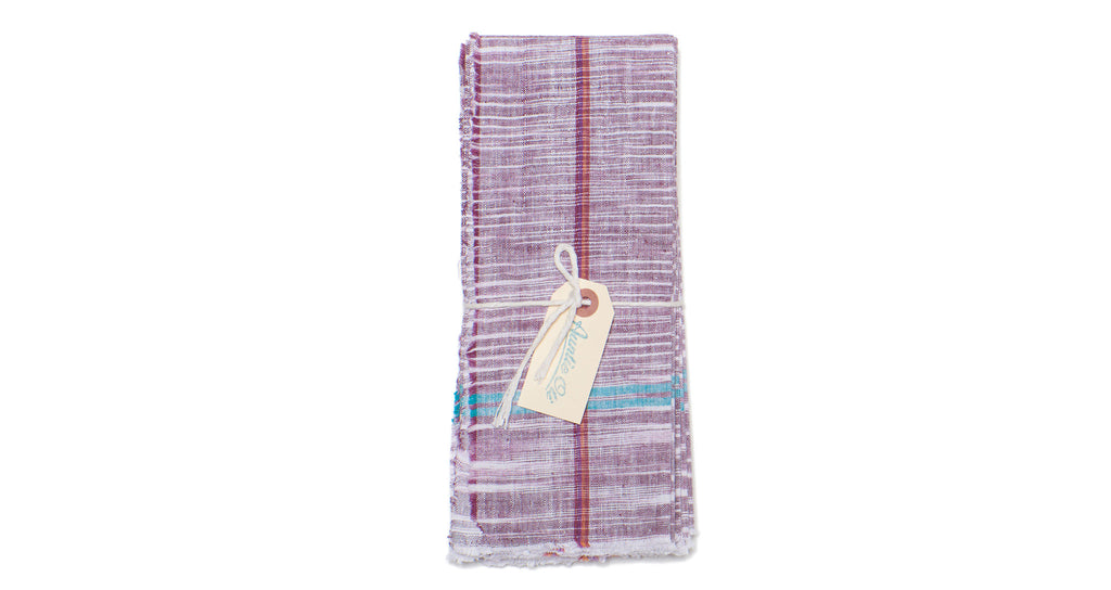 Full view of Cotton Napkin Set. Bring a colorful, rustic touch to your next meal with this hand-woven purple cotton napkin set with raw edges. Made with care in India.