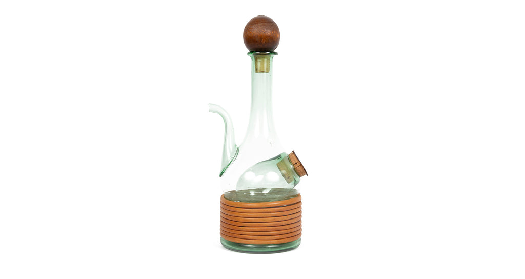 Vintage Italian Green Glass Decanter. Found by Lizzie, this one-of-a-kind vintage Italian de...