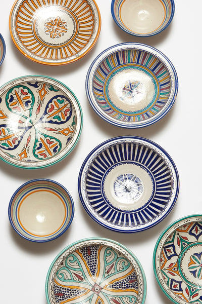 Thumbnail editorial shot of Fes Dishes, including the Fes Serving Dish In Kortoba. Serve up some international flair at your next dinner party with this one-of-a-kind hand-painted clay serving bowl from Fes, Morocco.