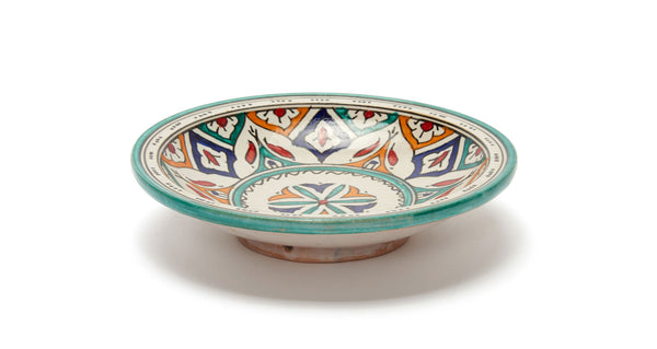 Full view of Fes Serving Dish In Kortoba. Serve up some international flair at your next dinner party with this one-of-a-kind hand-painted clay serving bowl from Fes, Morocco.