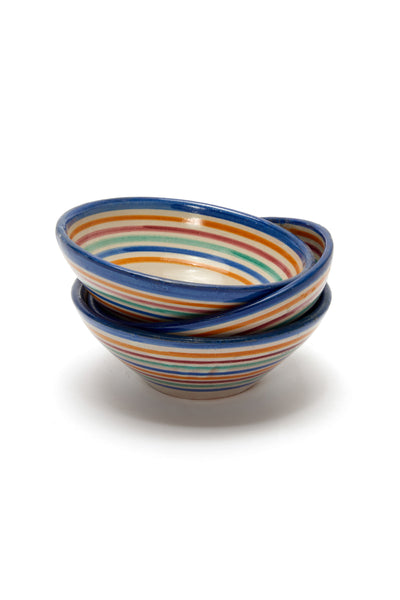 Thumbnail of stack of Fes Bowls In Prisma. Add some international flair to your tabletop with this fun rainbow striped clay bowl from Morocco.