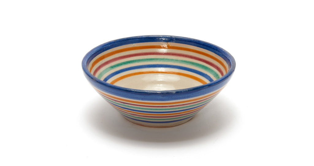 Full view of Fes Bowl In Prisma. Add some international flair to your tabletop with this fun rainbow striped clay bowl from Morocco.