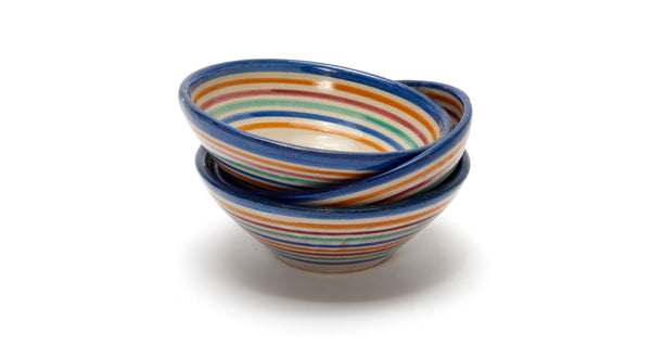 Stack of Fes Bowls In Prisma. Add some international flair to your tabletop with this fun rainbow striped clay bowl from Morocco.