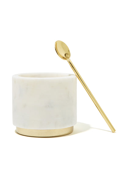 Thumbnail close-up of Mara Marble + Brass Sugar Pinch Pot. Constructed of hollowed white marble blocks and finished with a brass base + spoon, this dish makes a coolly classic addition to any counter or tabletop. Pair this diminutive beauty with the Hawkins creamer for a match made in coffee service heaven.