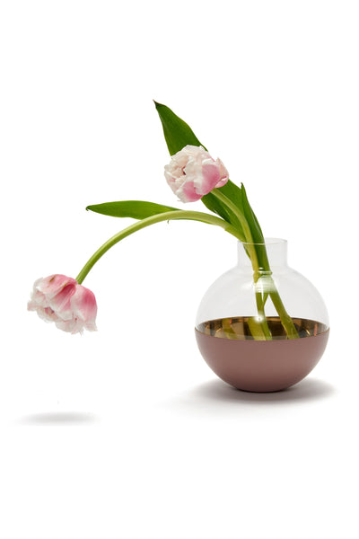 Thumbnail of Pomme Vase In Blush, holding tulips. The Pomme is a spherical vase and candle holder made of glass and polished brass, inspired by the graceful round shape of an apple ('pomme' in French). Created by Skultuna, the famed 400-year old Swedish metal-smithing company, this objet d'art can hold cut flowers or a tea-light in its base.