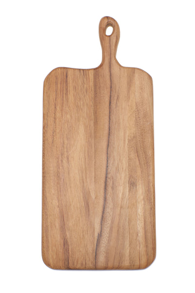 Thumbnail close-up of Long Cutting Board. Here's a cutting board that might attract as much attention as the things you put on it. With clean organic lines to emphasize the natural state of the wood, rounded edges for a comfortable grip, and generous sizing to fit all your holiday spreads.  Ethically sourced and hand-crafted from caro caro wood by a cooperative artisan group in Guatemala.