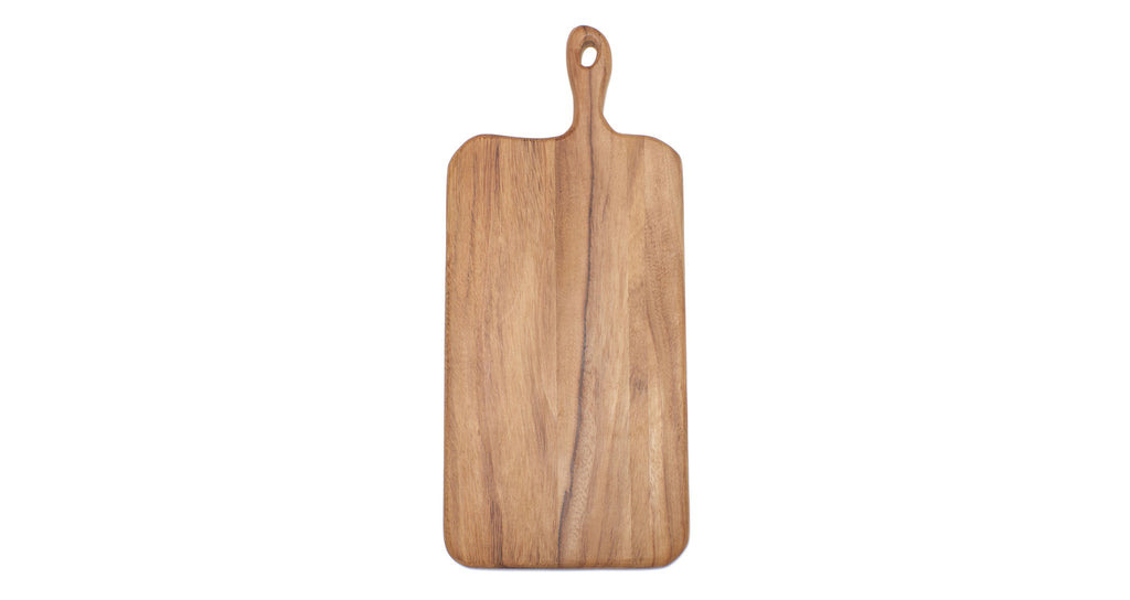 Full view of Long Cutting Board. Here's a cutting board that might attract as much attention as the things you put on it. With clean organic lines to emphasize the natural state of the wood, rounded edges for a comfortable grip, and generous sizing to fit all your holiday spreads.  Ethically sourced and hand-crafted from caro caro wood by a cooperative artisan group in Guatemala.