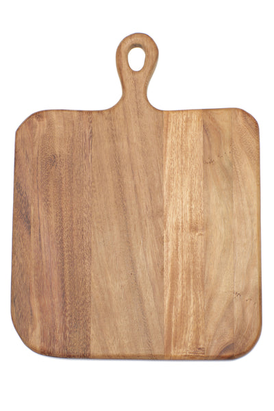 Thumbnail close-up of Square Cutting Board. Here's a cutting board that might attract as much attention as the things you put on it. With clean organic lines to emphasize the natural state of the wood, rounded edges for a comfortable grip, and a generous square size to fit all your holiday spreads. Oh, and it's great for serving pizza on!  Ethically sourced and hand-crafted from caro caro wood by a cooperative artisan group in Guatemala.