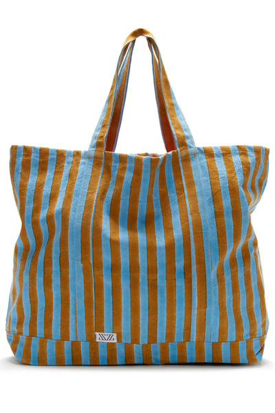 Thumbnail close-up of Oversized Striped Tote. This massive and durable canvas tote will be the one you reach for all summer long-- for beach days, farmer's market runs, and overnight stays. The cheery stripes were block-printed by hand in Jaipur.
