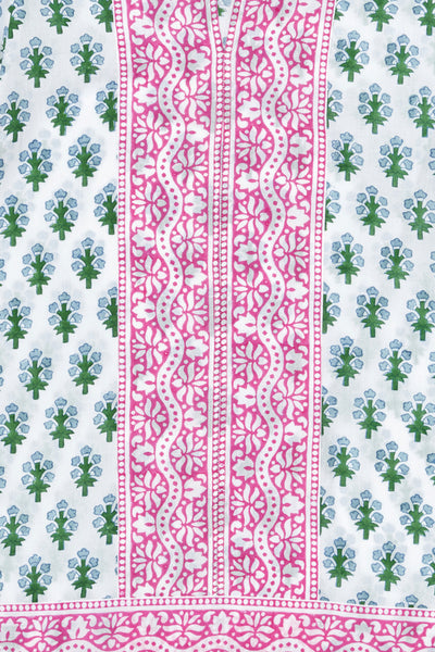 Thumbnail pattern detail of Short Kurta In Green/Blue Floral. This flattering and versatile tunic is tailored for a relaxed, boxy shape, with contrasting pink border trim at the sleeves, hem, and down the center. Perfect to throw on over a bathing suit, or with a pair of white jeans.