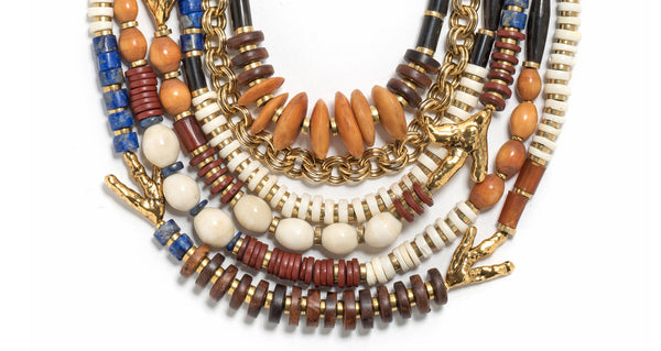 Bottom detail of Medina Necklace. A wealth of sumptuous details make this multi-strand mixed-media necklace a striking sight to behold. In a one-of-a-kind combination of bone, African glass, lapis and wood beads, and pearl and onyx semiprecious stone inlays.
