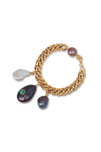 Thumbnail of The Baroque Charm Bracelet in Midnight. Turn on the charm in one (or both!) of our new gold-plated thick link chain bracelets. Showcasing hanging freshwater pearls and abstract acrylic drop charms, these chunky bracelets are a perfect match for all your fall sweaters.