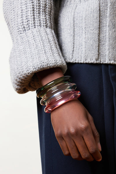 Thumbnail of model wearing the Triple Ridge Cuff In Tourmaline. Stack the style deck in your favor with our multicolored triple-domed cuff. This bracelet looks cool worn solo and, dare we say, even better layered with a classic Ridge or Meridian Cuff.