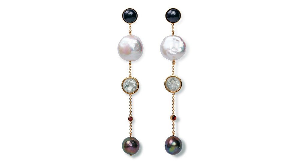 Full view of Bon Vivant Earrings. Oh la la! Be the life of every soiree in this pair of sparkly stunners. Our gold vermeil chain column earrings are dotted with a sophisticated mix of onyx, pearls, faceted green amethyst and tiny garnets.