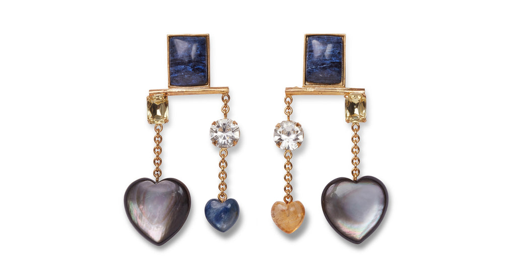 Full view of Lucky Earrings. We're up all night to get lucky in gold-plated chandelier statement earrings awash in dramatic tones of blue. With navy quartzite rectangle stone tops and hanging vermeil chains with faceted crystals, black mother-of-pearl, kyanite, and citrine hearts.