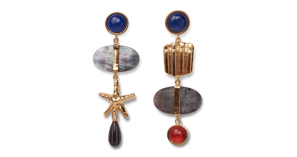 Full view of Kerala Earrings. Keep them guessing in these playfully mismatched earrings inspired by Lizzie's coastal travels. Our linked statement pair includes lapis cabochon tops, gold-plated shell and star, black mother-of-pearl discs and smoky quartz and carnelian cabochon drops.