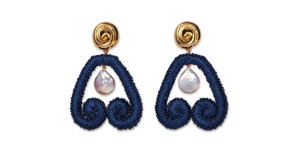 "Full view of Scroll Earrings In Navy. Here's a fresh way to wear pearls -- hang them inside our navy metallic embroidered ""scroll"" earrings for an eye-catching mix of materials.  With gold-plated ""nautilus"" tops to play up that sophisticated sea vibe."
