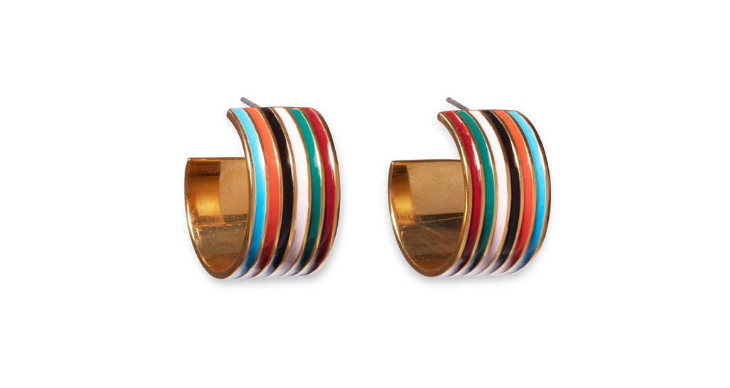 Full angled view of Margot Hoops In Rainbow. Nothing wrong with chasing rainbows. You'll be beaming confidence in this unique pair of wide gold-plated hoop earrings painted with multicolor striped enamel.