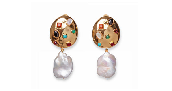 Full view of La Bomba Earrings. Meet the La Bomba clip-on earrings-- aka the pair that off-duty supermodel dreams are made of. Ageless, gorgeous, and most of all fun, these gold ovals are studded with a colorful smattering of semi-precious stones and punctuated with large freshwater pearl drops.