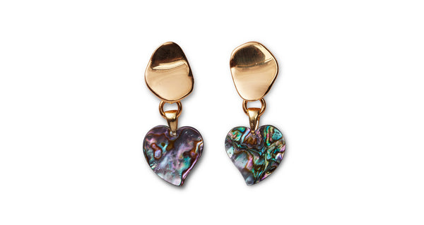 Full view of Abalone Heart Earrings. Have your heart set on wearing the grooviest earrings this season? Look no further than this gold-plated abstract pair, with hanging abalone heart charms that shine with a lustrous iridescence.