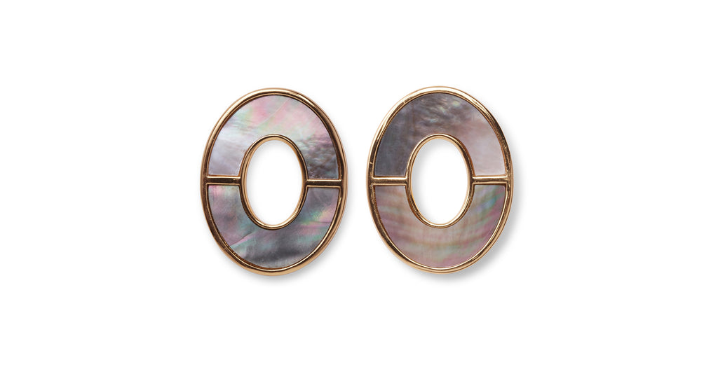 Full view of Symmetry Earrings In Iridescent. How to bring some serious polish to all your basics? It's simple geometry in our oval stud earrings with bisected black mother-of-pearl inlay.