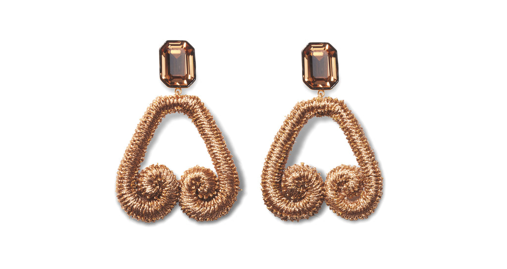 Full view of Scroll Earrings In Bronze. Embrace a return to the bronze age in our metallic b...