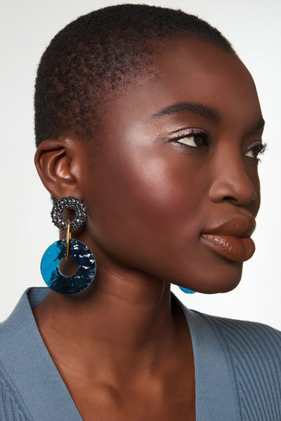 Thumbnail of model wearing Indigo Earrings. We could talk a blue streak about this pair of beautiful hand-beaded earrings with gold-plated links and hanging indigo-colored glass discs. Try them on and you'll understand our excitement!