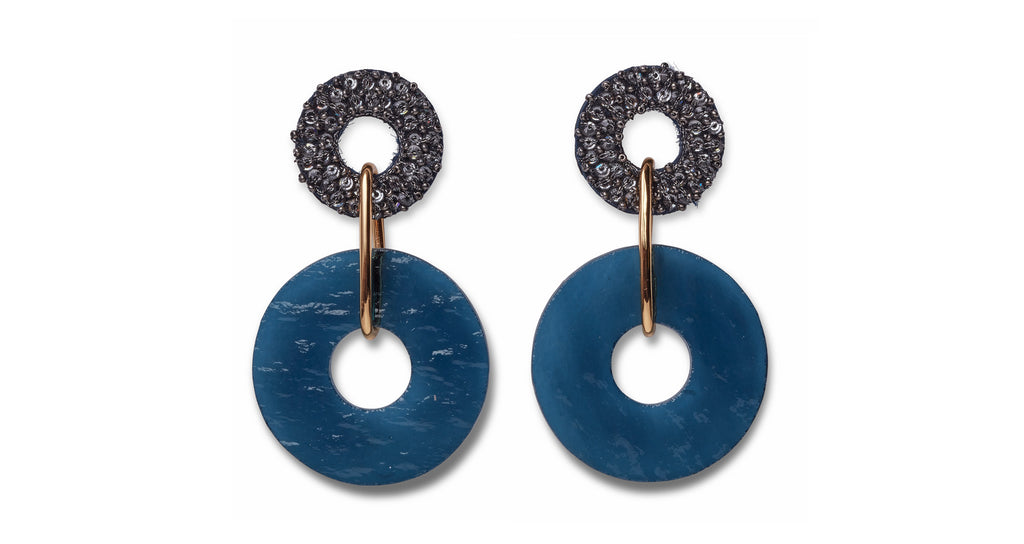 Full view of Indigo Earrings. We could talk a blue streak about this pair of beautiful hand-beaded earrings with gold-plated links and hanging indigo-colored glass discs. Try them on and you'll understand our excitement!