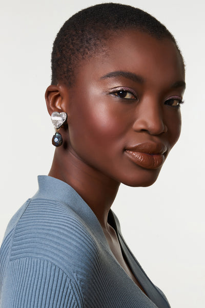 Thumbnail of model wearing French Heart Earrings. Panic at the disco! Start a style riot at your next party in the hand-beaded silver earrings with peacock-colored freshwater pearl drops. Bonus: these are clip-ons for easy, lightweight wear.
