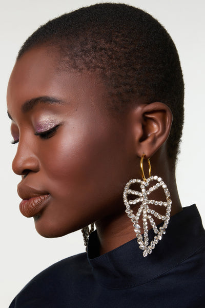 Thumbnail of model wearing the Crystal Leaf Earrings. These. Are. Major. We cannot wait to wear the gold vermeil hoop earrings with elaborate handmade crystal leaves. Classic, with a statement-making sparkly twist.