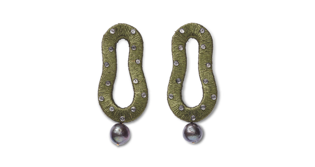 Full view of Escher Earrings In Olive. This is not an optical illusion -- these hand-woven metallic green thread abstract earrings are indeed your new must-have statement accessory. With glass beads and hanging peacock-colored pearl drops.