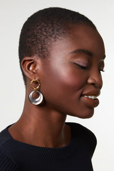 Thumbnail of model wearing Abalone Disc Earrings. The height of understated sophistication, these textured gold-plate earrings with hanging abalone discs will take you from the boardroom to your next brunch date.