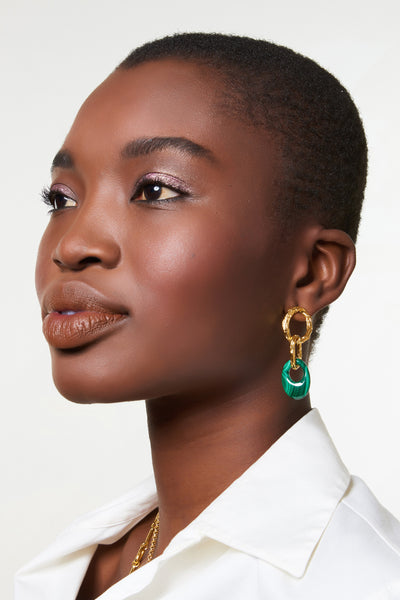 Thumbnail of model wearing Evergreen Earrings.  We're giving the green light to these sophisticated triple link earrings in textured gold-plating with malachite stone ovals. The pair provides a richly dramatic pop of color against a crisp white shirt (or anything else you're wearing, for that matter).