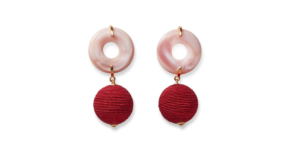 Full view of Saffron Drop Earrings. Mad about saffron? Mellow out in the sweetest pink mother-of-pearl disc earrings with burgundy hand-woven drops.