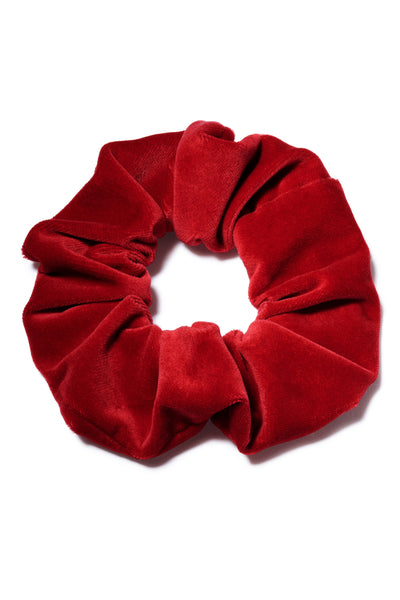 Thumbnail close-up of Velvet Scrunchie In Scarlet. All hail the return of the scrunchie, everyone's favorite fabric-covered elastic hair tie! Our version amps up the luxury factor in scarlet red velvet. The humble ponytail is about to get very stylish.