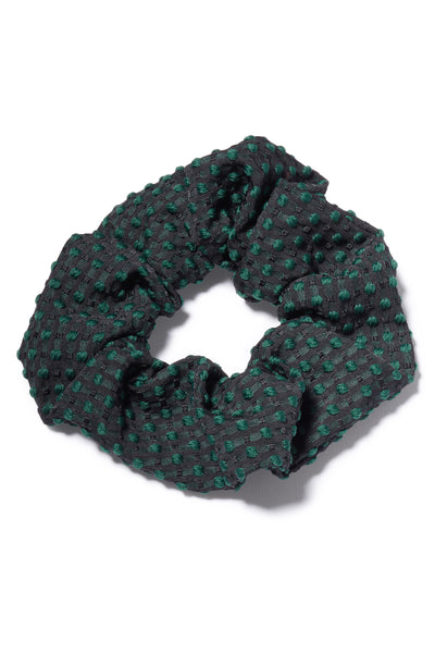 Thumbnail close-up of Swiss Dot Scrunchie. All hail the return of the scrunchie, everyone's favorite fabric-covered elastic hair tie! Our version amps up the luxury factor in green swiss dot silk jacquard.