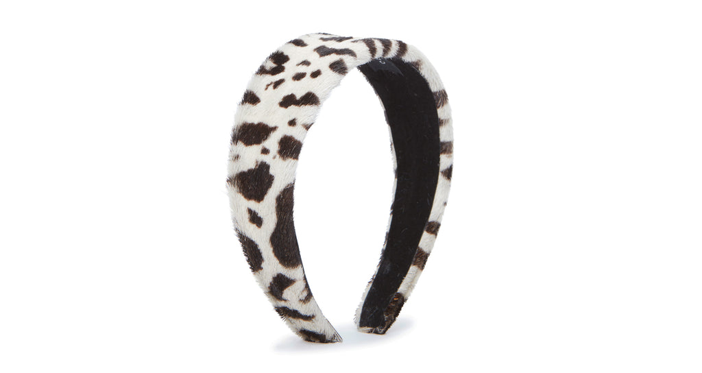 Full view of Safari Headband In Black And White. We've officially gone wild for this statement headband, featuring black and white animal-print calf hair.