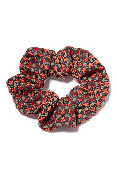 Thumbnail close-up of Crimson Floral Scrunchie. All hail the return of the scrunchie, everyone's favorite fabric-covered elastic hair tie! Our version amps up the luxury factor in a crimson floral patterned silk jacquard.