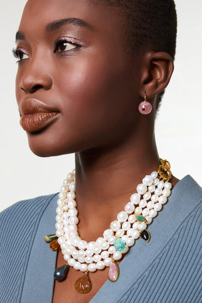 Thumbnail of model wearing Amber Necklace. This multi-strand freshwater pearl statement necklace with semi-precious stones is an heirloom piece in the making; we'll be wearing it forever with our chunkiest sweaters and slinkiest evening gowns.