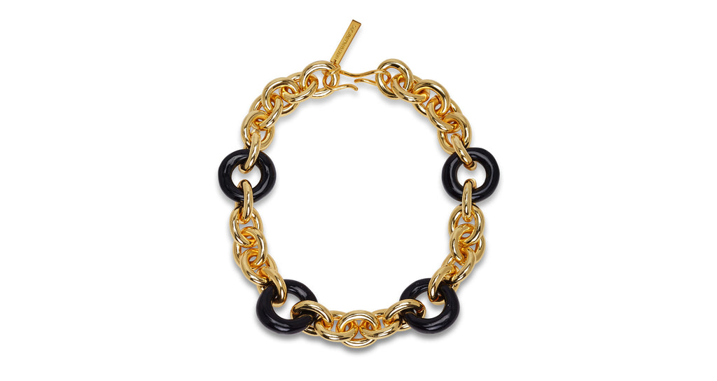 Full view of Zodiac Collar. Keep it classic but make it bold -- you'll be good as gold in our chunky collar necklace with oversized black acrylic links.