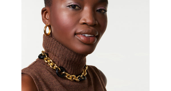 Model wearing the Zodiac Collar. Keep it classic but make it bold -- you'll be good as gold in our chunky collar necklace with oversized black acrylic links.