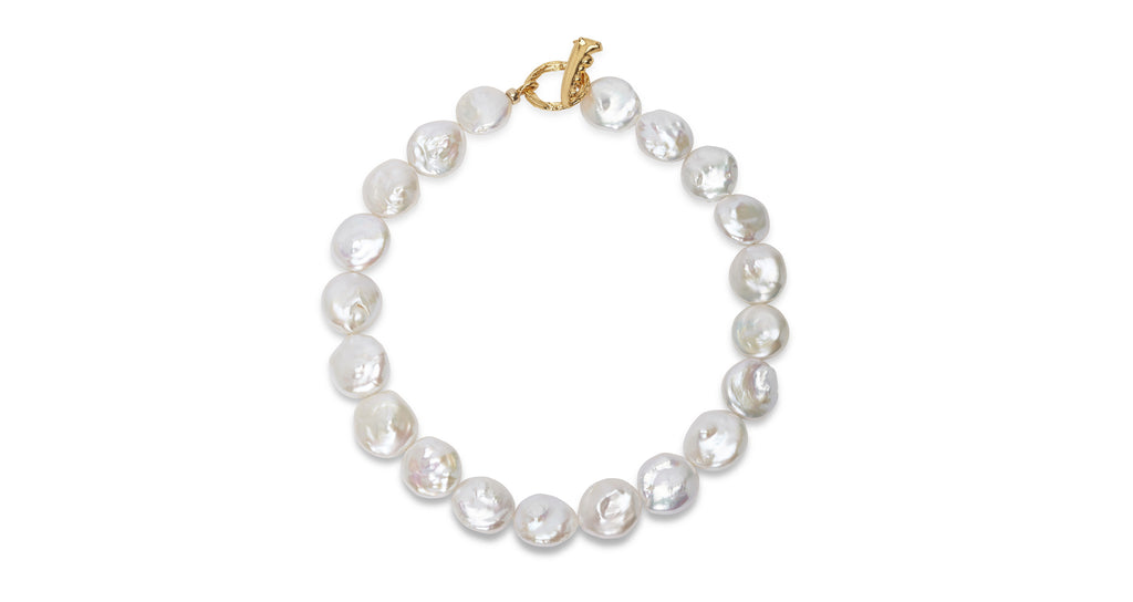 "Full view of Goa Pearl Collar. The world is your oyster in this elegant update on the most timeless of accessories, the pearl necklace. Featuring freshwater coin pearls with gold-plated ""claw"" toggle closure. A wardrobe classic for you, your mother, or your best friend."