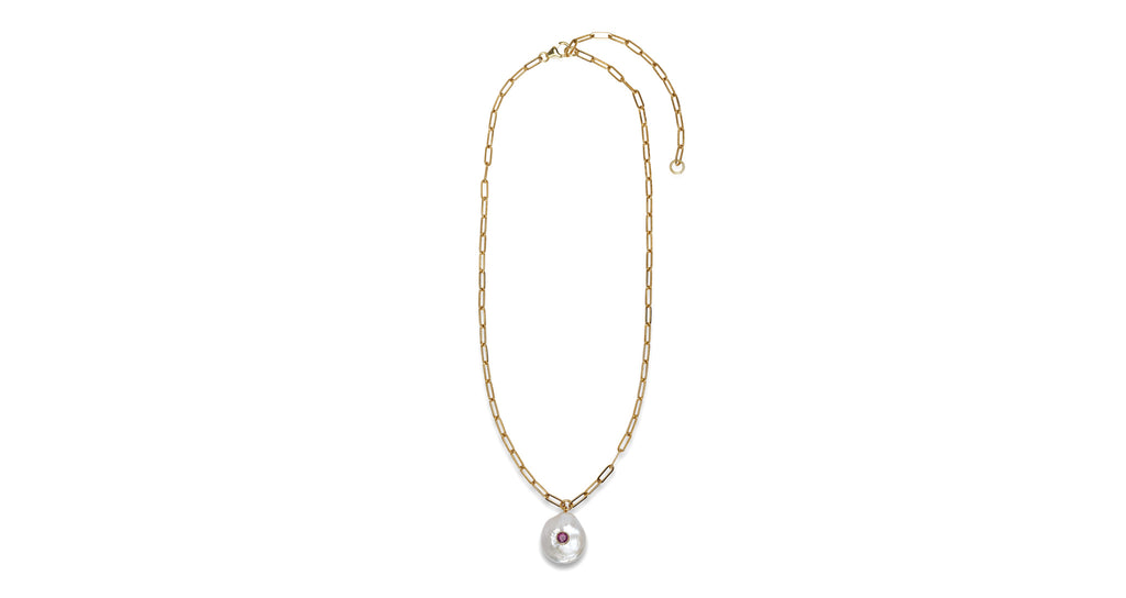 Full view of Red Eye Pearl Necklace. Bring good vibrations to your wardrobe in this simple, elegant gold vermeil chain necklace with freshwater coin pearl pendant and faceted pink tourmaline detail. We truly want to wear this one everyday.