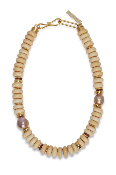 Thumbnail close-up of Old City Necklace. Take a turn into neutral territory in our cream single-strand bone bead necklace. With gold-plated and freshwater pearl accent beads, it goes with everything and loves to layer.