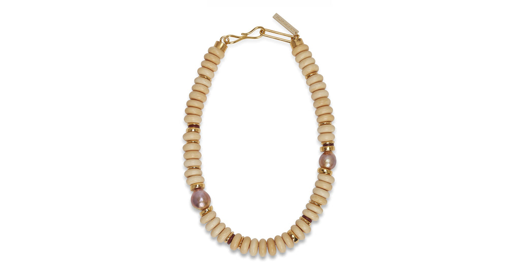 Full view of Old City Necklace. Take a turn into neutral territory in our cream single-stran...