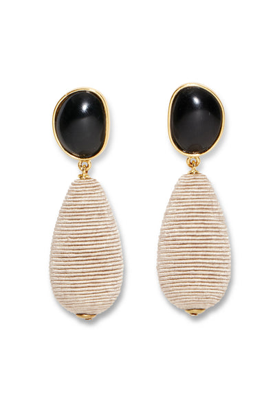 Thumbnail close-up of Onyx Drop Earrings. We're feeling this sophisticated, one-of-a-kind pair of earrings for days at the office that turn to nights out on the town. With hand-cut black onyx cabochons and beige woven cord drops, consider these your unique wardrobe weapon.