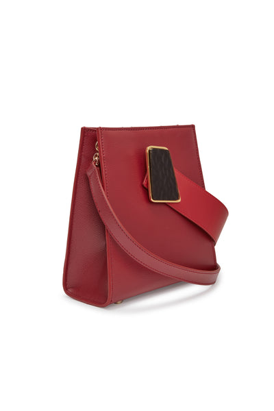 Thumbnail side view of Pronto Purse In Geo Red. There's no other way to go -- this red leather structured mini bag is simply irresistible. Featuring a red leather top handle, abstract textured glass detail and detachable cross-body strap. This is power-dressing at its finest.