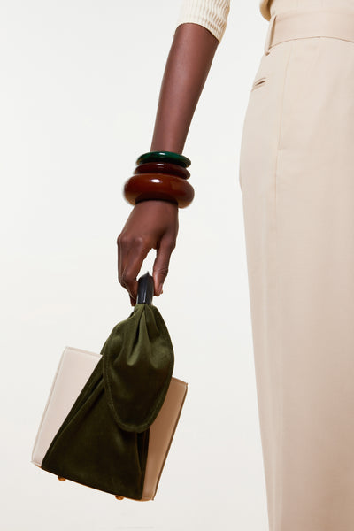 Thumbnail model carrying the Florent Bag In Olive. Get ready to carry the purse everyone's g...