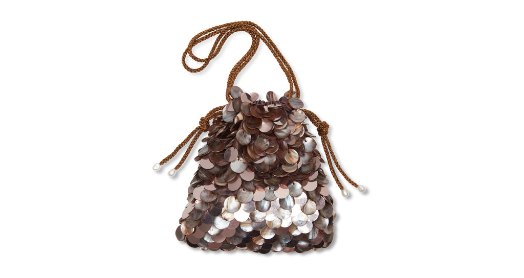 Full view of Gala Wristlet In Sundown. Calling all mermaids. This gorgeous drawstring purse ...