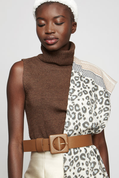 Thumbnail of model wearing Agnes Belt In Tan Leather. Check out the impeccable detailing on our favorite newer wide belt silhouette with oversized square buckle. This one's rendered in a gorgeous shade of tan saffiano leather for all your wardrobe needs.